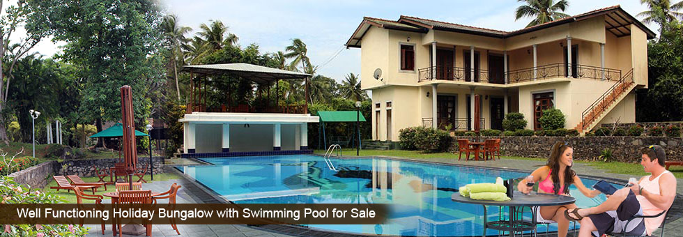 Well Functioning Holiday Bungalow with Swimming Pool for Sale situated in Kadawatha, just 2 Km to Kandy Rd. Fully tiled and wooden floor right round, furnished consist 10 fully A/C comfortable rooms with attached bathrooms, 3 rooms with self contained kitchen.
