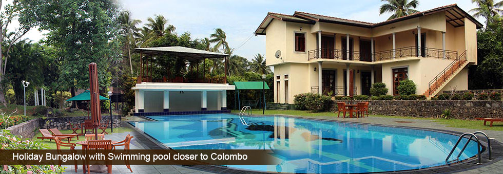 Holiday Bungalow with large swimming Pool available for sale situated in Kadawatha, just 2 Km to Kandy Rd. Fully tiled and wooden floor right round, furnished consist 10 fully A/C comfortable rooms with attached bathrooms, 3 rooms with self contained kitchen.